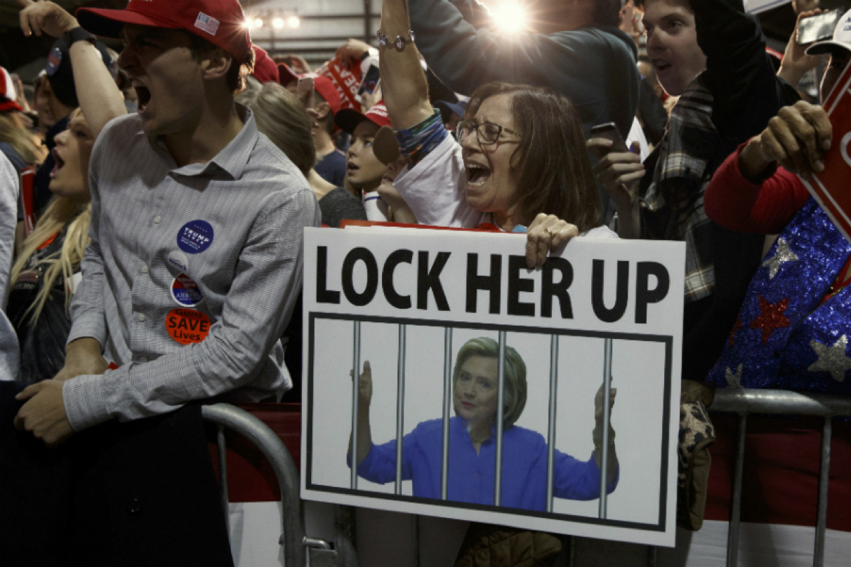 "Protestors chant ""lock her up"""